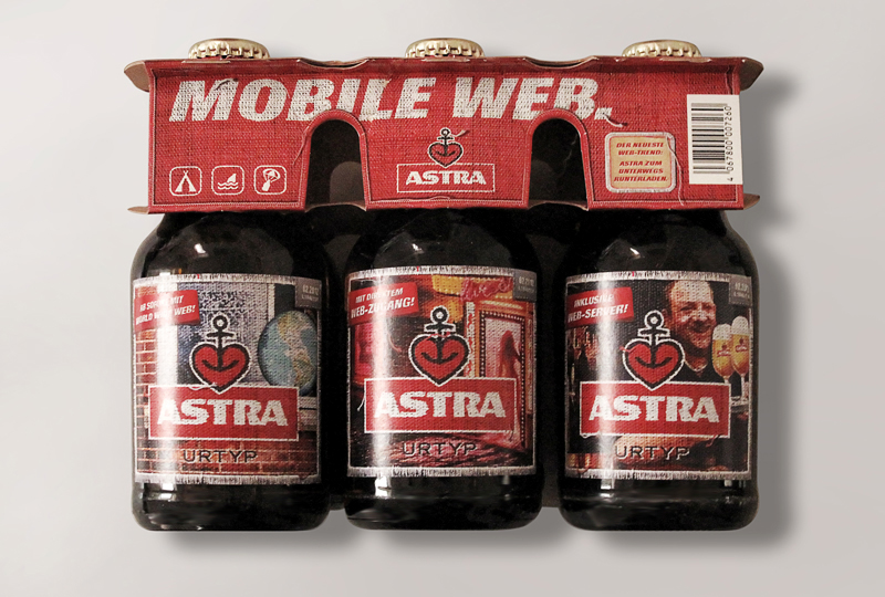 "LassalMedia – Astra Beer 6pack showing some of the ""Mobile Web"" Campaign labels."